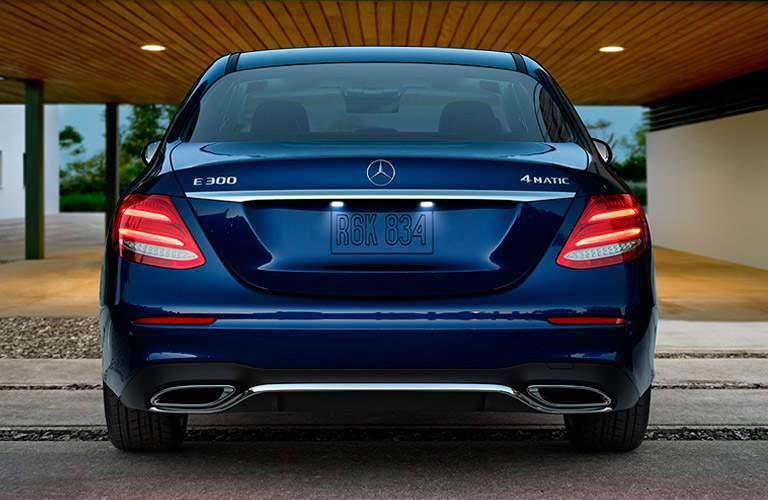 Blue 2017 Mercedes-Benz E-Class Rear Exterior in Front of House