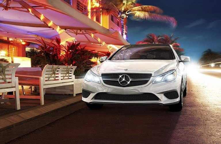 White 2017 Mercedes-Benz E-Class Coupe Front Exterior on Main Street at Night next to Restaurant