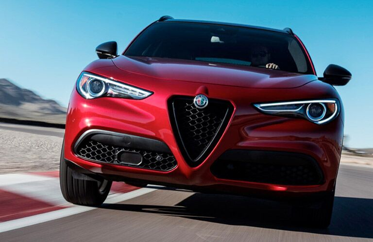 Red 2018 Alfa Romeo Stelvio Front Exterior on a Track