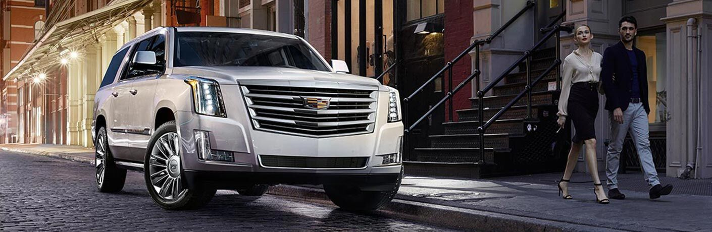 Silver 2018 Cadillac Escalade on a City Street