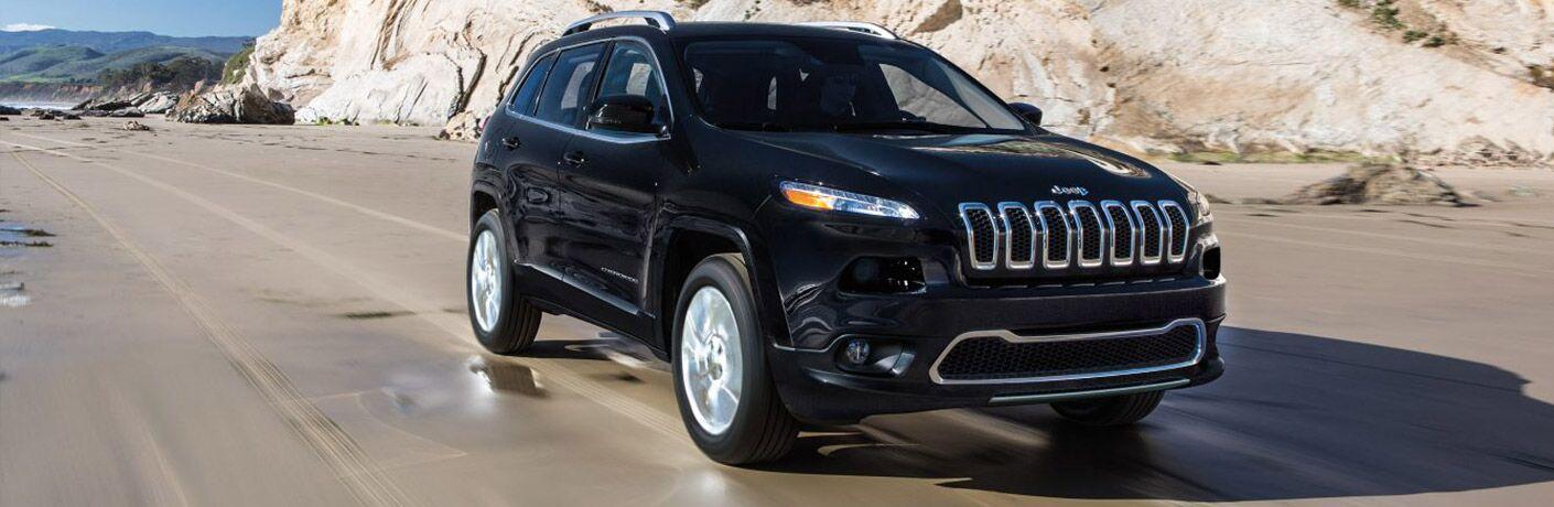 Black 2018 Jeep Cherokee on a Sand Beach