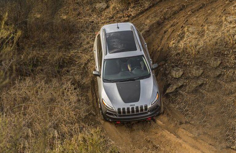 Silver 2018 Jeep Cherokee Trailhawk on a Mud Trail