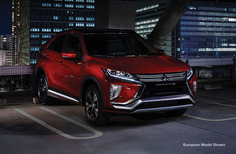Red 2018 Mitsubishi Eclipse Cross in a Parking Structure