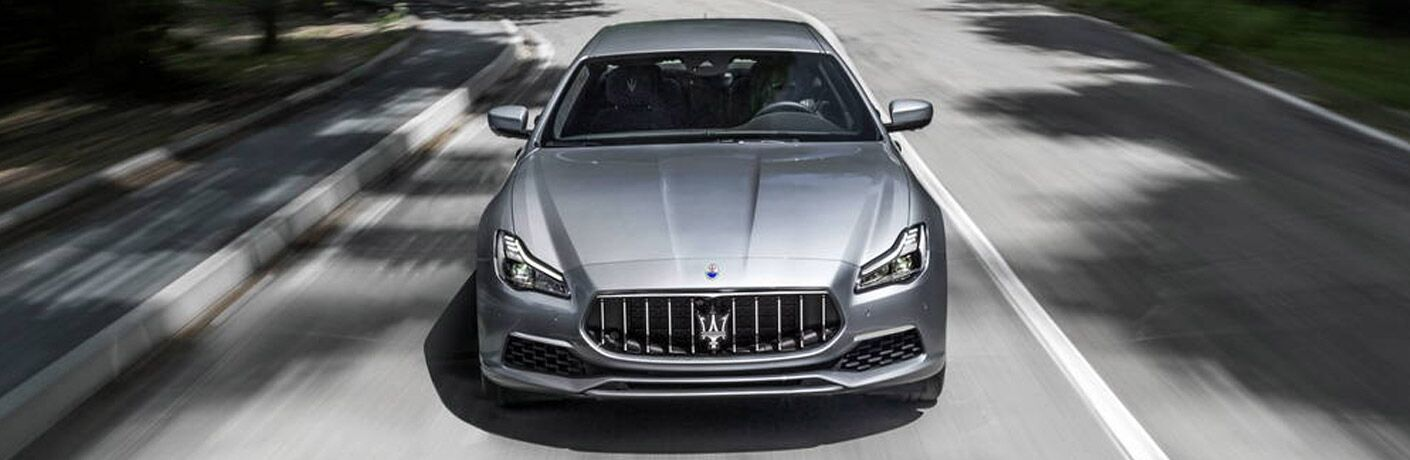 Silver 2018 Maserati Quattroporte Front Exterior Driving on a City Street