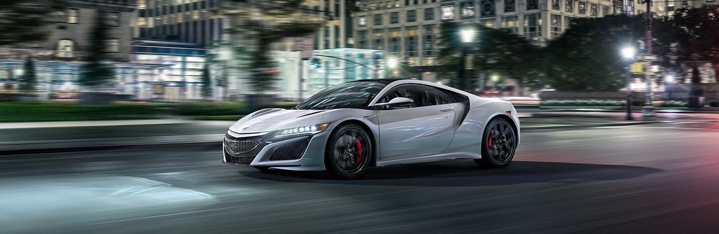 Silver 2019 Acura NSX on a City Street at Night