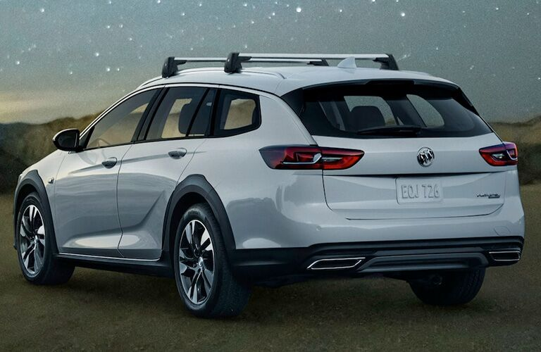 White 2019 Buick Regal TourX Rear Exterior in a Field at Night
