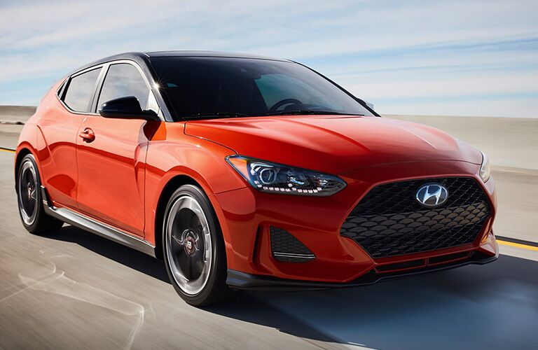 Red 2019 Hyundai Veloster Driving on a Freeway