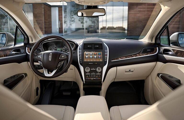tan interior of lincoln mkc vehicle