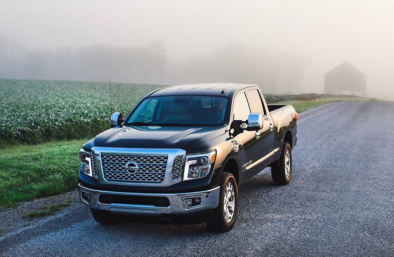 Black 2019 Nissan Titan XD at a Farm
