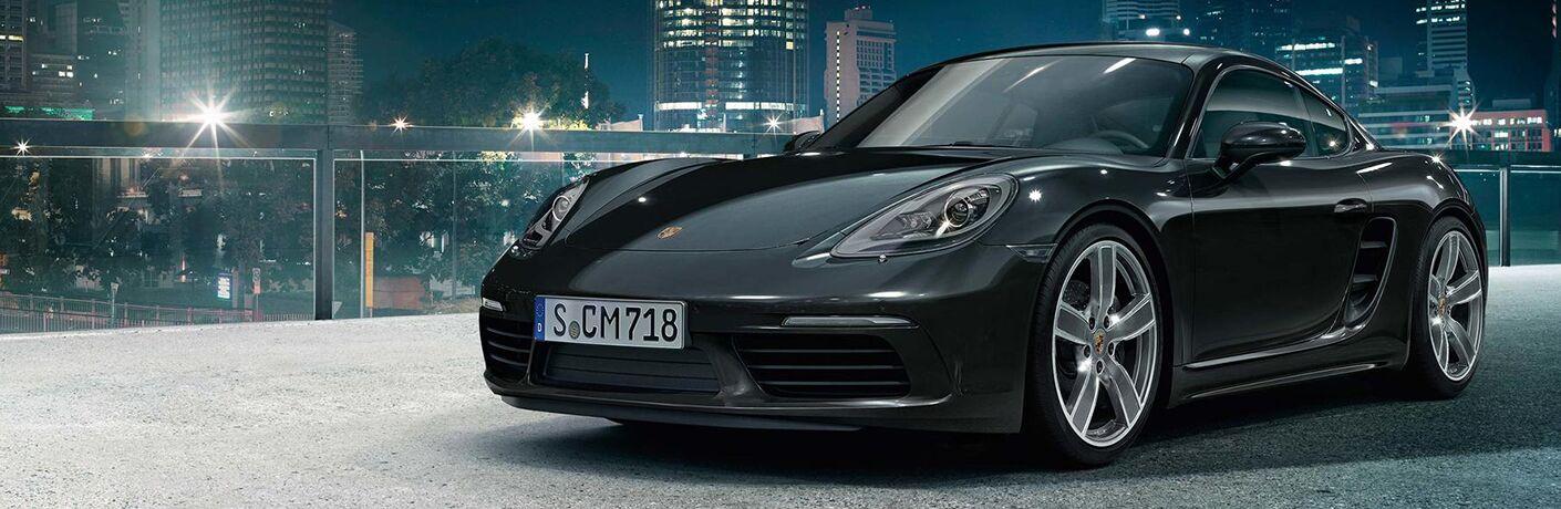 Black 2018 Porsche Cayman on City Street at Night