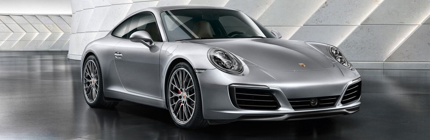 Gray 2019 Porsche Carrera in a Modern Building