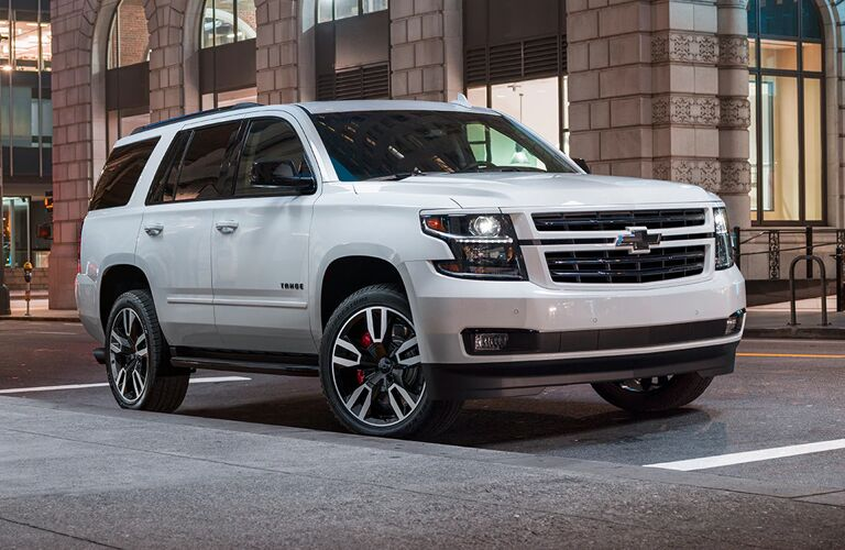 2020 Chevy Tahoe exterior front fascia passenger side in front of brick building