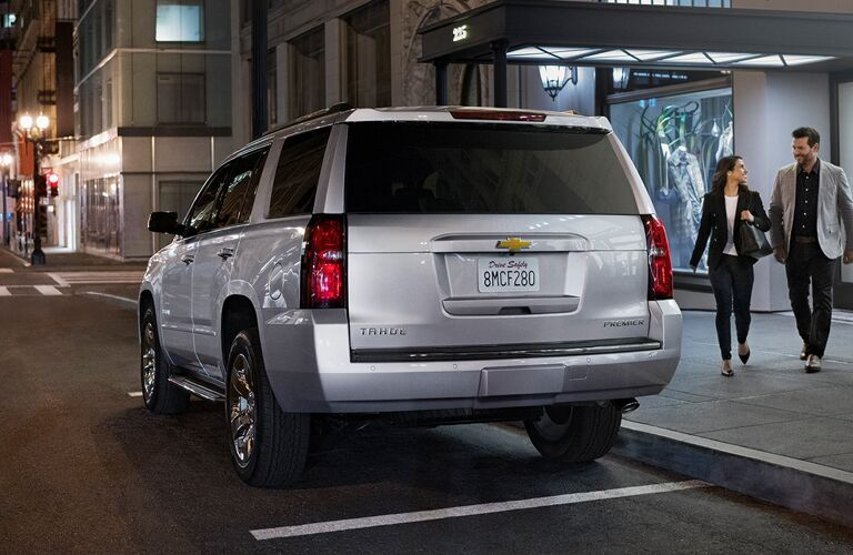 2020 Chevy Tahoe exterior back fascia driver side in parking space with couple walking towards it