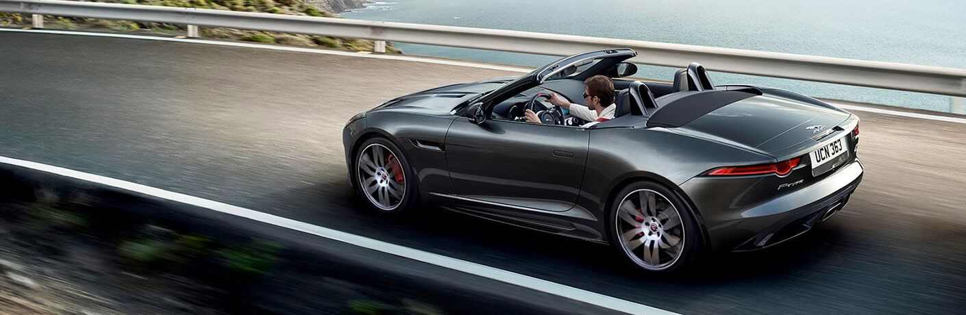 Gray 2020 Jaguar F-TYPE Convertible on Coast Road with Top Down