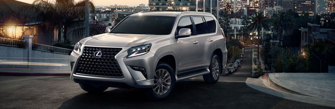 Silver 2020 Lexus GX on a City Street at Night