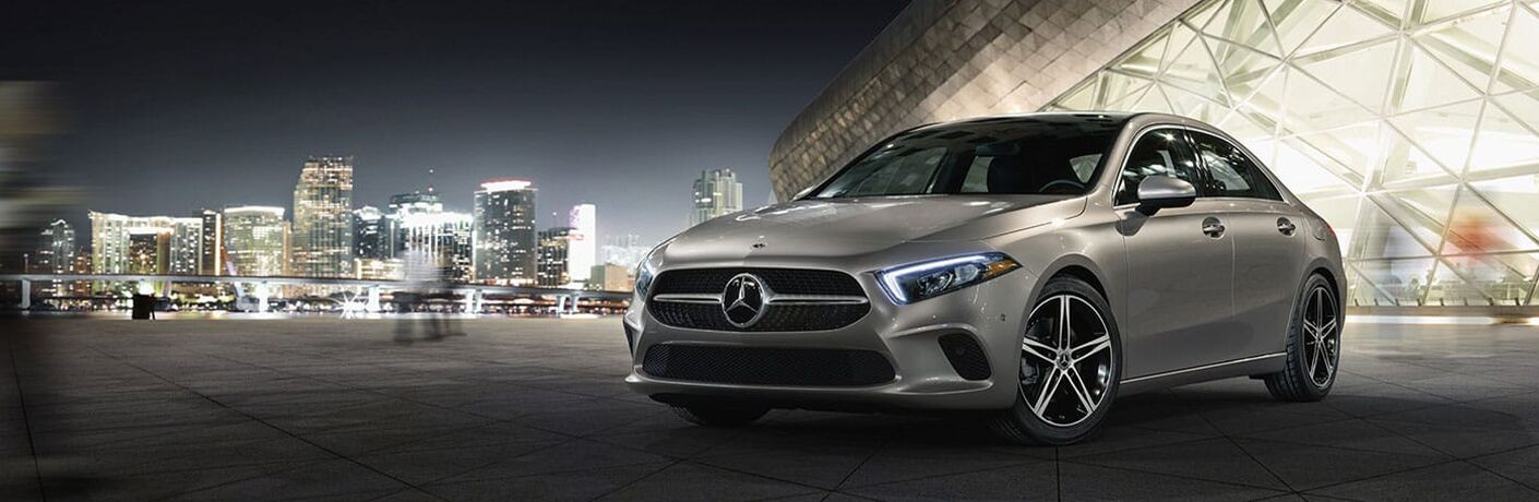Gray 2020 Mercedes-Benz A-Class in Front of City Skyline at Night