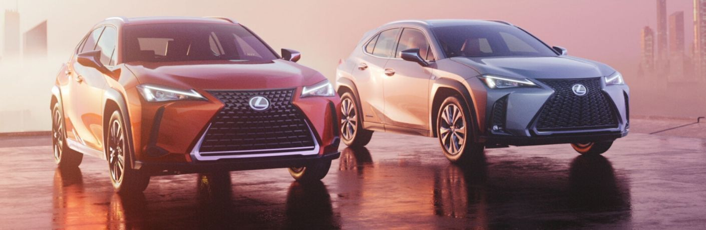 Orange and Silver 2020 Lexus UX Models in a Parking Lot