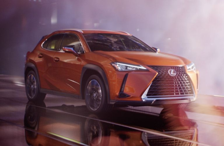 Orange 2020 Lexus UX on Wet Street