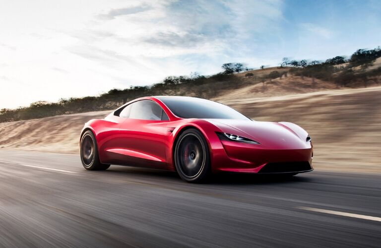 Red Tesla Roadster on a Highway