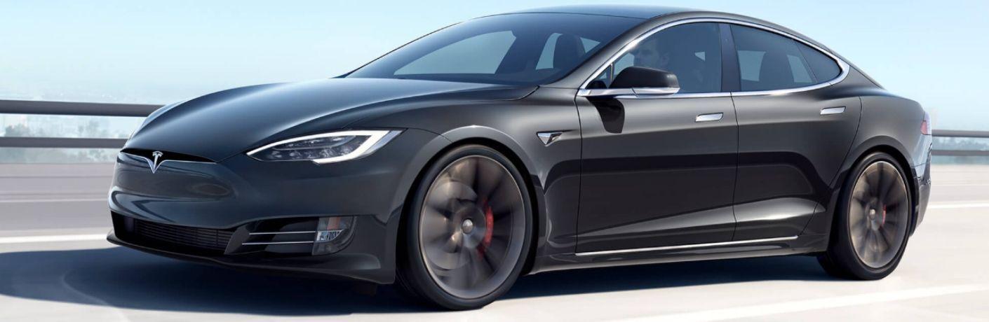 Black Tesla Models S on a Freeway Bridge