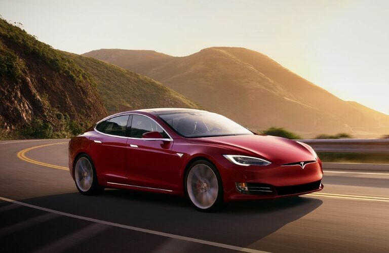 Red Tesla Model S on a Mountain Highway
