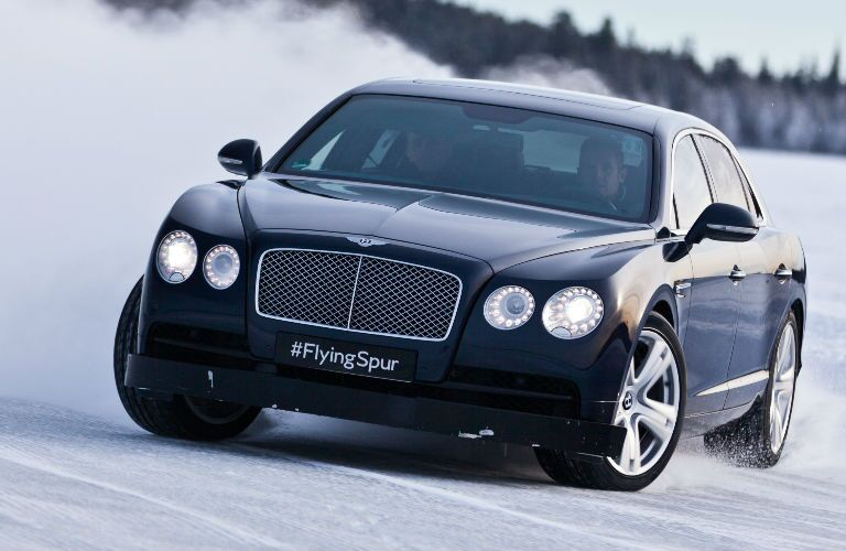Black Bentley Flying Spur Drifting in Snow