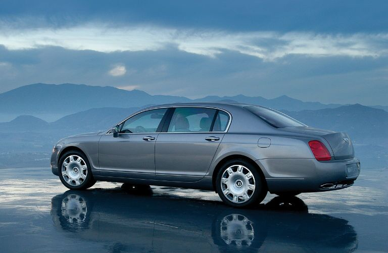 Gray Bentley Flying Spur on Wet Sand