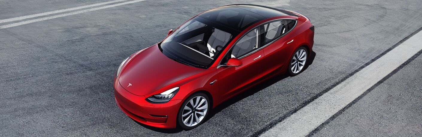 Overhead Image of a Red Tesla Model 3 on a Track
