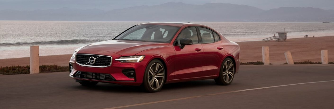 Red 2019 Volvo S60 at the Beach