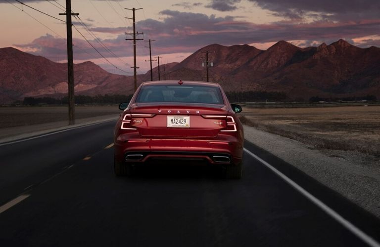 Red 2019 Volvo S60 Rear Exterior on a Desert Road at Dusk