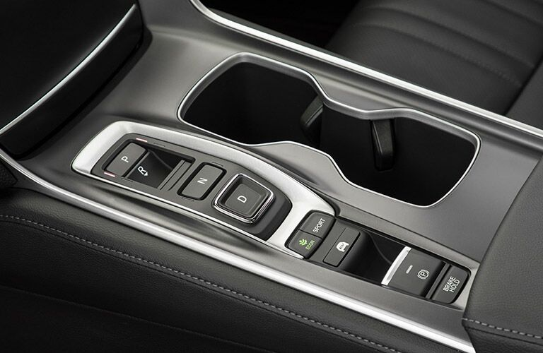 cup holders and drive mode controls inside the 2018 Honda Accord Hybrid