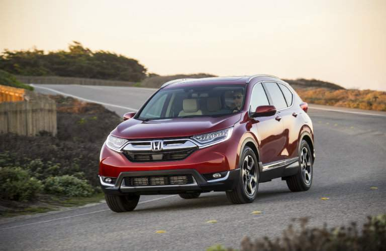 2018 Honda CR-V driving down rural highway