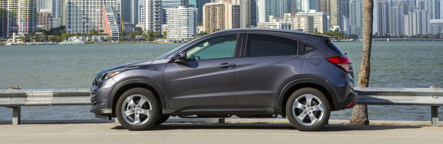 2019 Honda HR-V exterior drivers side profile with city and lake in background