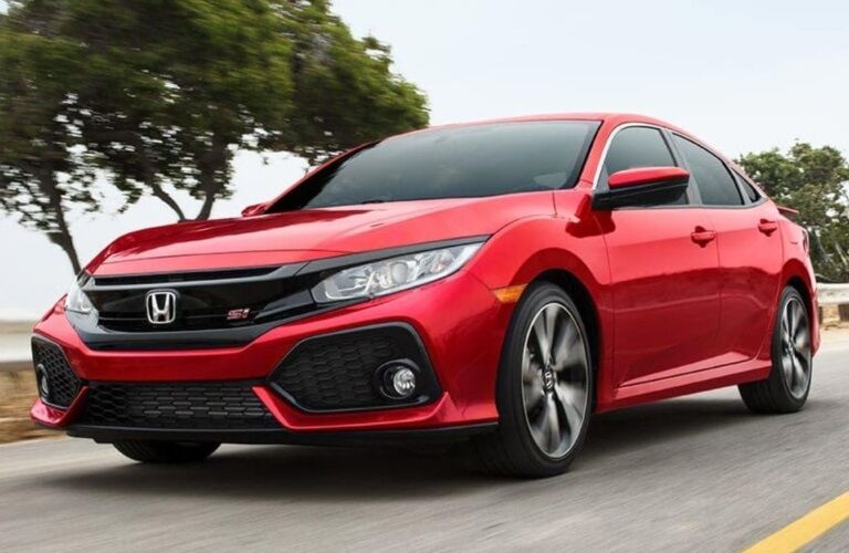 Red 2019 Honda Civic Si driving on open road