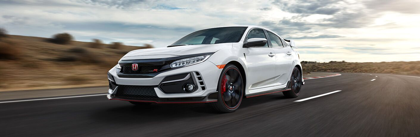 2020 Honda Civic Type R exterior front fascia driver side low view on racetrack with blurred background