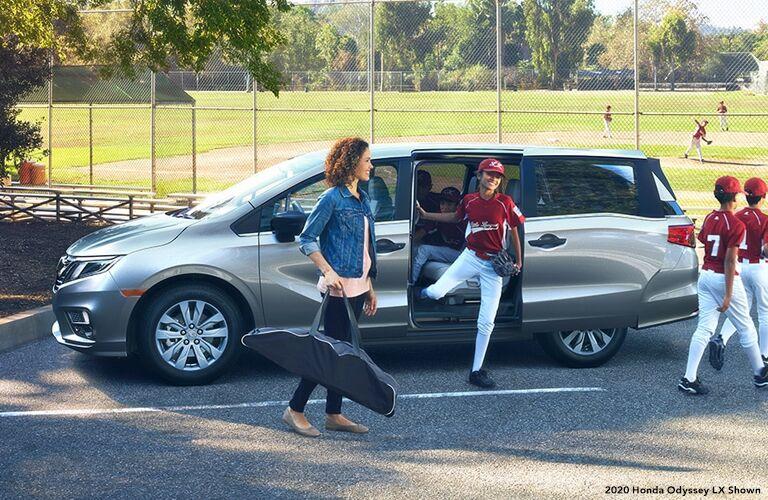 2020 Honda Odyssey exterior driver side mom and boy baseball players leaving