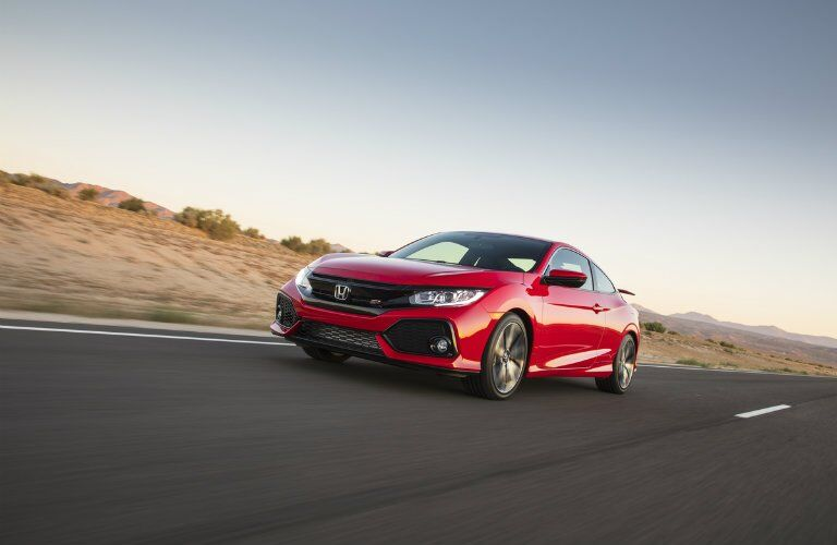 2017 Honda Civic Si driving down the road
