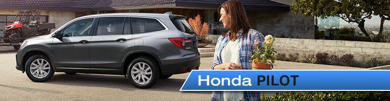 white 2019 Honda Pilot with banner in bottom right corner