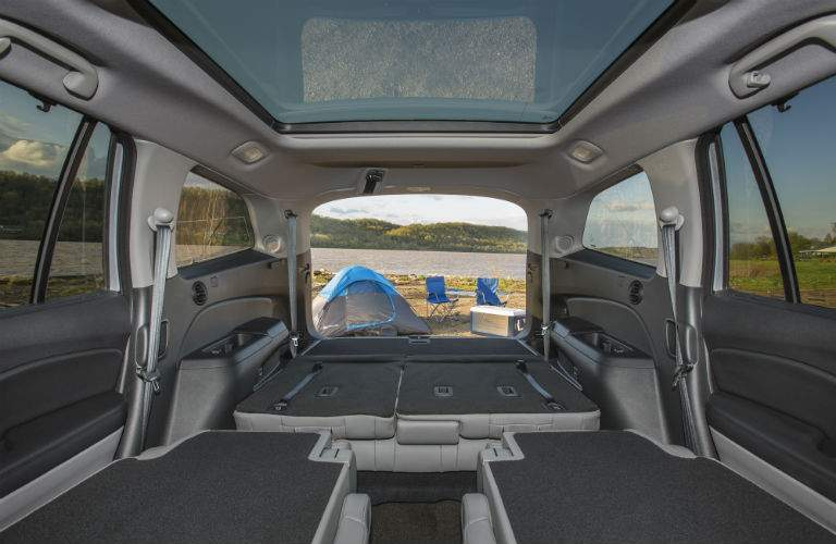 view of rear cargo area with seats folded down from within the front of the Honda Pilot
