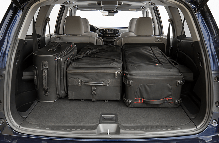 2019 Honda Pilot rear cargo area with luggage in it