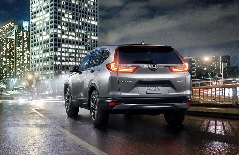 Silver 2019 Honda CR-V driving through city at night