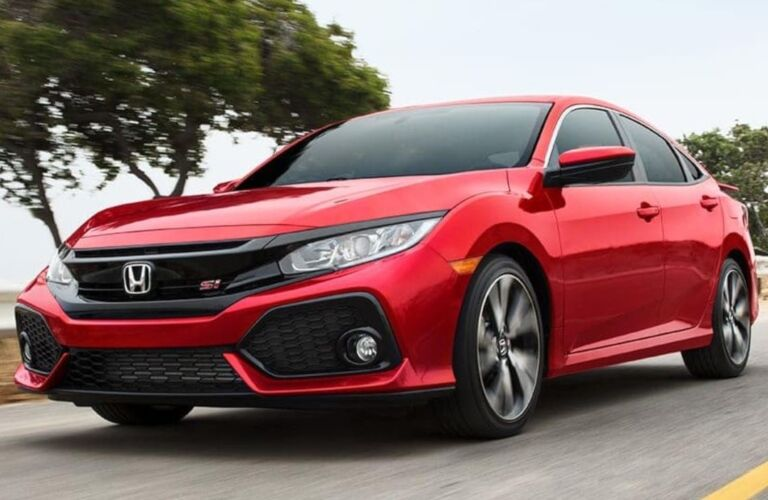 Front side view of a red 2019 Honda Civic Si