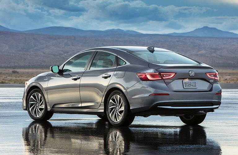 Gray 2019 Honda Insight in front of mountain landscape