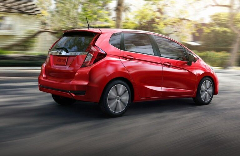 Red 2020 Honda Fit driving