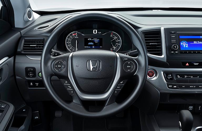 2020 Honda Ridgeline interior close up of steering wheel and gauge display