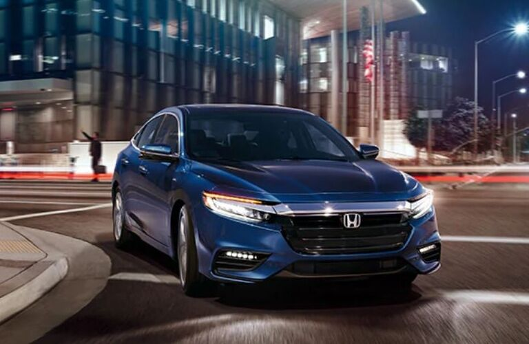 Blue 2020 Honda Insight driving in city at night