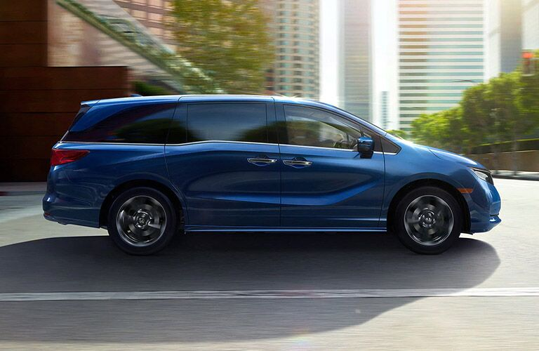 2021 Honda Odyssey blue exterior passenger side driving in city