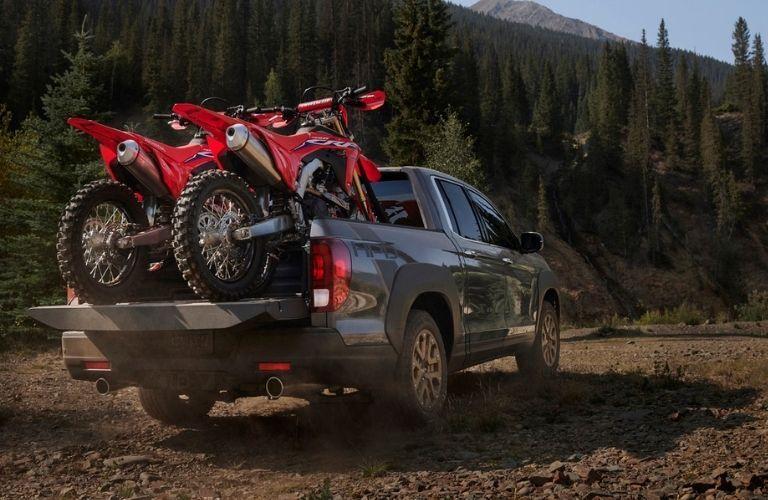 2021 Honda Ridgeline with motorbikes in truck bed