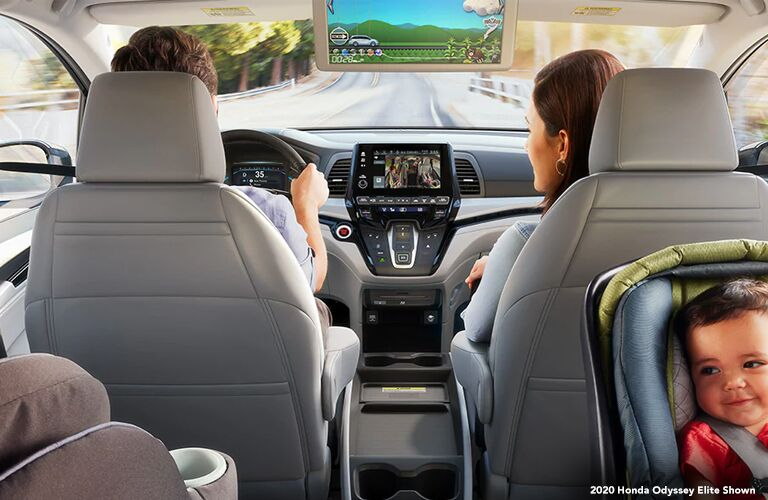 Interior showing entertainment screen and front half of 2020 Honda Odyssey
