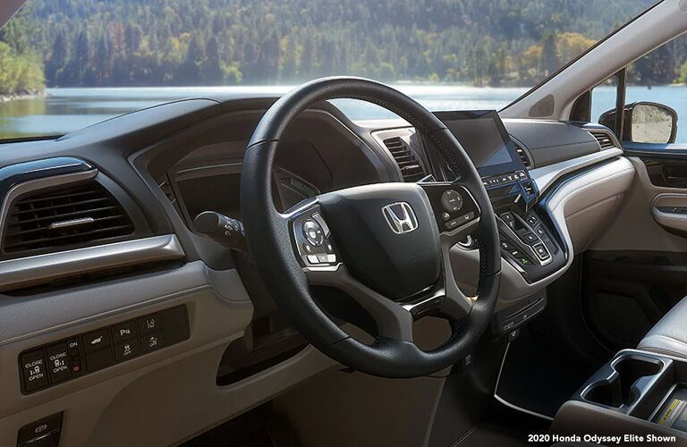 Interior view of front dash and steering wheel on 2020 Honda Odyssey